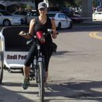A Redi Pedi pedicab driver rides in Jacksonville, Florida.