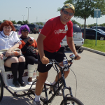 MegaCon attendees take a pedicab ride at the Orange County Convention Center in Orlando, Florida.
