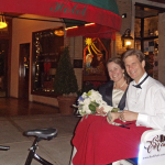 Bride and groom enjoy a bridal pedicab rides down Park Avenue in Winter Park, Florida during their wedding day.