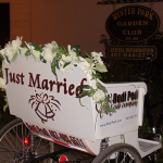 Redi Pedi offers bridal bicycle carriage rides at a wedding at the Winter Park Garden Club in Winter Park, Florida.