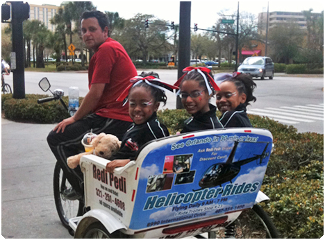 Redi Pedi pedicabs roll around International Drive like a mobile billboard with advertising while offering rides to visitors.