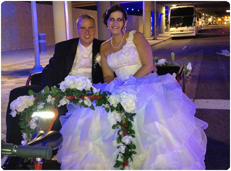 Newly weds take a pedicab ride in downtown Orlando, Florida to their hotel following their wedding reception.
