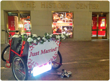 A bridal pedicab waits at the Orlando History Center in Downtown Orlando for the exit of the bride and groom from their wedding reception in downtown Orlando, Florida.
