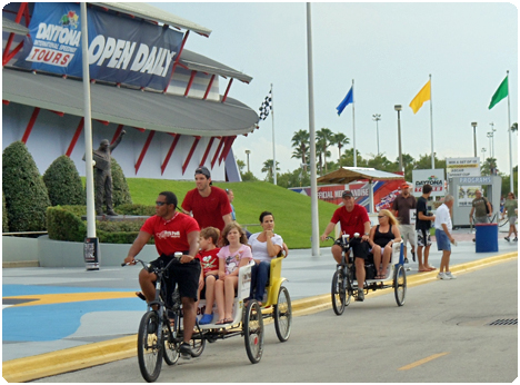 Redi Pedi pedicabs assist race fans at the Daytona International Speedway with getting around the grand stands and parking lots.
