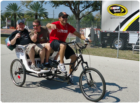 Race fans in Daytona Beach, Florida enjoy the races with Redi Pedi Pedicabs.