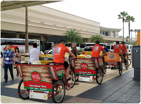Redi Pedi pedicabs wait for passengers and interact with convention attendees at the various pedicab staging areas located at the Orange County Convention Center.