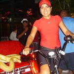 A Redi Pedi pedicab driver takes a ride on the wildside of International Drive in Orlando, Florida.